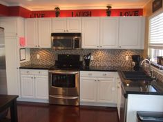 I like the idea have having the accent color running along the top of the cabinets, subtle yet sassy.