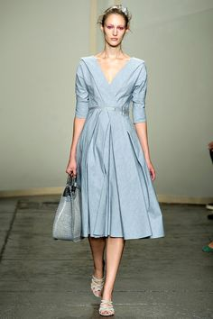 Donna Karan Spring Dresses-everything matches. Her shoes, handbag, and even her hairband. Not loud or trashy--simply elegant down to her pedicure.