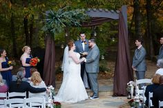 The arbor was beautifully decorated with swags of rich brown fabric, hanging globes, and a great spray of greenery
