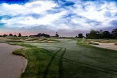 The 9th hole at Purgatory Golf Club. I love cart tracks in the dew.