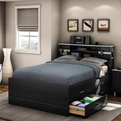 This is my master bedroom dream bed (the only way it could be better is if it were a queen/king).     South Shore Cosmos Full Captain Bed in Black Onyx.