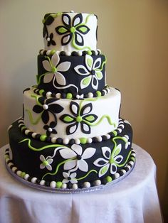 black and white fondant cakes images | This black and white fondant tier is covered in whimsical flowers with ...