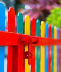 A fence painted with many colours.