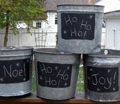 painted galvanized buckets | Old galvanized buckets with a patch of chalkboard paint.