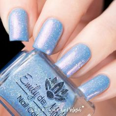 Emily de Molly The Tenth Running is a light blue holographic polish with pink shimmer and iridescent and silver holographic microglitter. This nail polish is de