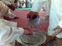 Balochi Culture washing Hand of Guest in Guest room
