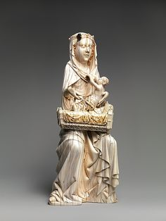Virgin and Child with Cradle.  Date:     ca. 1350–1400. Geography:     Made in Upper Rhineland, Germany. Culture:     German. Medium:     Ivory, traces of polychromy