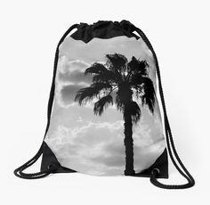 'Palm Trees In Black and White' Drawstring Bag by ARTbyJWP from Redbubble #bag #drawstringbag #fabricbag #backpack #artprints #buyart  #palmtrees #blackandwhite ---   Black and white capture of palm trees silhouettes on a cloudy sky. • Also buy this artwork on home decor, apparel, stickers, and more.