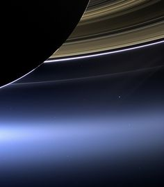 You are here: Saturn, backlit, seen by the Cassini spacecraft, with Earth just below the rings. This picture was taken from 1.4 billion kilometers away.  Photo by NASA/JPL-Caltech/Space Science Institute