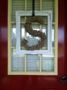Front door decor...Repurposed  Old picture frame with letter made from wire clothes hanger & threaded with 2 inch strip burlap