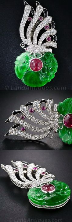 Art Deco Carved Jade, Diamond, Ruby and Onyx Clip.  A highly translucent circular carved jade with a vibrant emerald-green color surrounds a bright-red cabochon ruby and is crowned by a sparkling, highly stylized diamond butterfly accented with small cabochon rubies and black onyx calibre, in this exceptionally beautiful and exciting Art Deco jewel, exquisitely handcrafted in platinum - circa 1925.