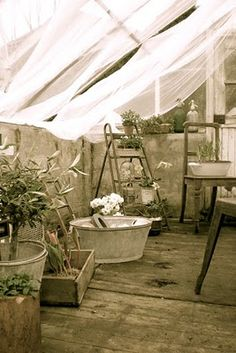 Outdoor room for washing with a fresh breeze.Let water & soap splatter & drip, no floor clean up. Curtains to diffuse light in greenhouse