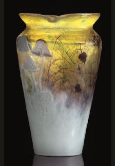 Mushroom Marqueterie-Sur-Verre Intercalaire Vase, circa 1895. glass, applied and wheel-carved, intercalaire, High:18.5cm, engraved mark Gallé. Sold at GBP 54500 on 3 Oct 2007, Christie's.