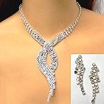 Wholesale rhinestone jewelry provides a necklace set with a waving cascade dropping from the center of the necklace.  The set comes in clear or iridescent stones—the rhinestone color preferred for prom jewelry this season.  http://www.awnol.com/store/Rhinestone-Jewelry/Rhinestone-Sets