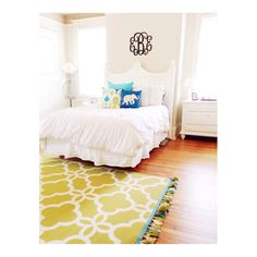 Love the crisp white with the pops of color and of course the monogram letters above the bed!! Pretty!