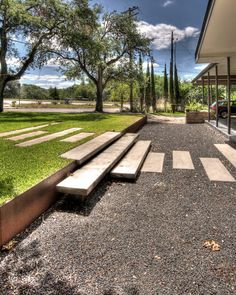 Austin, Texas-based landscape design firm D•CRAIN uses steel in many of their projects. Here, it acts as a retaining wall for a level change between gravel and grass.