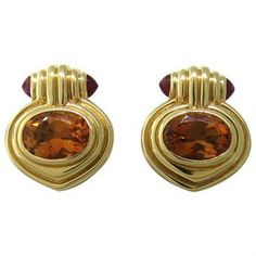 Bulgari 18k gold earrings with faceted citrine stones and two ruby cabochons each DESIGNER: Bvlgari MATERIAL: 18K Gold GEMSTONE: Ruby, Citrine DIMENSIONS: Earrings are 20mm x 17mm WEIGHT: 20.2g MARKED