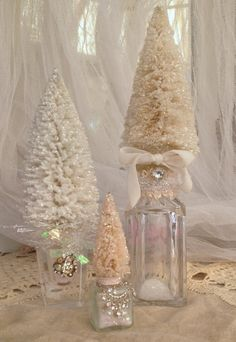 This listing is for 3 shabby upcycled bottles into Christmas decor. One Crystal Cruet, one crystal salt shaker, one miniature vintage salt