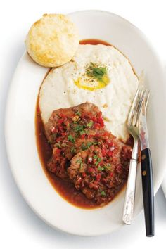 "Grillades made their published debut as early as 1885. They are boneless medallions of veal, except when the cook substitutes bone-in ""7 steaks,"" pork medallions, or beef tenderloin. And contrary to your French-English dictionary definition, they are never grilled. Rather, they are simmered in Creole-Italian red gravy, including enough tomatoes or tomato paste to color and flavor but not dominate the sauce. The meat has to be spoon-tender, neither melted into the gravy nor totally separate…"