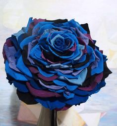 composite bouquets are one large flower made by gluing many petals together.  This is done with rose petals.