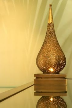 Arabesque lamp, gold lantern   Shape in design and texture in materials.