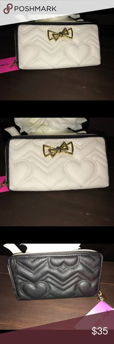 Betsey Johnson Quilted Black & White Wallet So cute and great size! Traction all wallet size, white quilted with gold accents. The inside is adorable gold and classic BJ floral print! Had a convenient ID window!!!  I noticed a tiny imperfection in the side which is photographed. Metal is still covered with plastic!!  Always fast shipping and love in packaging  Betsey Johnson Bags Wallets