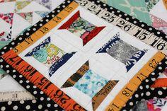 Spools mini quilt, 6 inches square.