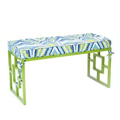 Green indoor/outdoor bench with peacock cushion.