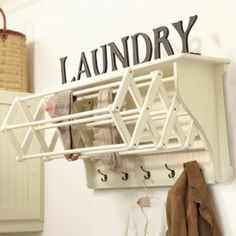 by Ballard Designs.  Corday Accordian Drying Racks - $179.00 Wow! This coat rack, does double duty as a hanging clothes drying rack. This is such a clever design, and super space saver.