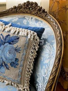 blue and white chair and cushion