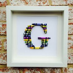HAND MADE PERSONALISED CRAYON NAME FRAME A PERFECT GIFT FOR CHRISTENING, NEW BABY, NAMING CEREMONIES AND BIRTHDAYS OR TEACHER These beautiful frames are handmade and are personalised with the first letter of your childs/teachers name or it could also be each letter in a separate