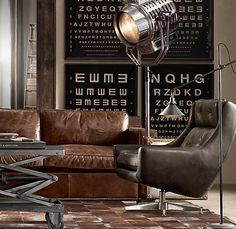 Strong, deep, rich, masculine colours. Vision test prints in white-on-black, i-beam in the doorway, industrial light, coffee table.