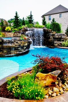 Concrete Swimming Pool with a Sand Colored  Plaster Beach Entry. Waterfall and Hot Tub Overflow. World Class Pools of Pittsburgh