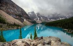 Moraine Lake is a glacially-fed lake in Banff National Park, 14 kilometres (8.7 mi) outside the Village of Lake Louise, Alberta, Canada. It is situated in the Valley of the Ten Peaks, at an elevation of approximately 6,183 feet (1,885 m). The lake has a surface area of .5 square kilometres (0.19 sq mi).  The lake, being glacially fed, does not reach its crest until mid to late June.