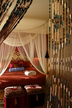 sheer white linens drapped as a canopygolds, reds, oranges, and blues.Moroccan-style decor at El Morocco Inn and Spa in Desert Hot Springs, CA Moroccan Design, Moroccan Decor, Moroccan Style, Moroccan Bedroom, Hot Springs, Apartment Therapy, Decoration, Bedroom Decor, Bedroom Ideas