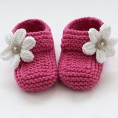 These special little shoes/booties have been knitted with lovely soft cotton blend yarn. They are adorable in raspberry pink with white knitted flowers finished with tiny buttons. The buttoned strap is for decoration only. They are light and comf. Baby Booties Knitting Pattern, Baby Shoes Pattern, Baby Knitting Patterns, Hand Knitting, Knitted Baby Boots, Crochet Baby Shoes, Crochet Baby Booties, Knitted Bags, Baby Clothes Patterns