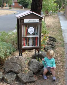 Rosalie Street repurposed an old cabinet and now it is this beautiful Little Library! She wrote a blog post about how she did, too: http://www.rosaliestreet.com/blog/2014/02/19/little-free-library