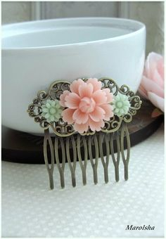 A Blush Pink Flower,Soft Mint Green Mum Collage Hair Comb. Bride Hair, Bridesmaids Hair comb, Wedding Comb. Gifts For Wife.  Sister Gift.. $18.90, via Etsy.