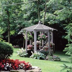 Design Ideas Small Gazebo, Big Effect - Even a small gazebo can have a big impact. The structure offers a great getaway at the edge of a wooded area and a view back toward the elaborately landscaped house. Plants fill the gazebo with color Gazebo Pergola, Building A Pergola, Gazebo Ideas, Outdoor Rooms, Outdoor Gardens, Outdoor Living, Dream Garden, Home And Garden, Small Gazebo