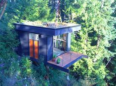 Customer experience consultant Peter Frazier built this inspirational treetop office after decades of feeling disconnected from nature. Set amongst the trees above Chuckanut Bay in Bellingham, Washington, his lofted cube serves as a workspace and guest room, and it has a green roof on top too.