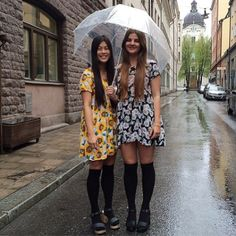 Ebba and Janice from @americanapparelsweden brave summer showers in Floral Printed Babydoll Dresses and matching knee socks! #AmericanApparel