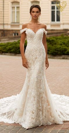 Romantic lace mermaid wedding dress with sweetheart neckline off the shoulder straps and long train for the sophisticated bride | Val Stefani Spring 2021 Wedding Dress - Monaco/D8266 - Belle The Magazine #weddingdress #weddingdresses #bridalgown #bridal #bridalgowns #weddinggown #bridetobe #weddings #bride #dreamdress #bridalcollection #bridaldress #dress See more gorgeous bridal gowns by clicking on the photo