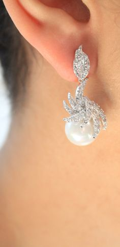 Check out this item in my Etsy shop https://www.etsy.com/listing/248952190/white-pearl-earrings-cubic-zirconia