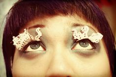 These pretty paper eyelashes feature a giant kraken giving a galleon a final loving embrace.  ((kayla, us to the EXTREME)).