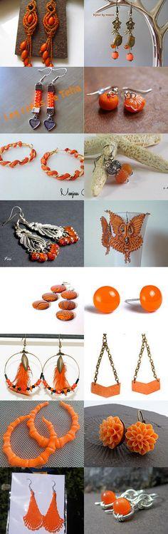 Les créoles à plumes tigrées.  Boucles d'oreilles oranges by Reriro on Etsy--Pinned with TreasuryPin.com
