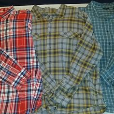 Bundle of three MEN'S long sleeved button downs Three shirts, but just one price! Also just one shipping price! All shirts have a chest measurement of 28 inches across laying flat. Red plaid is 100% cotton and New With Tags. Two blue plaid shirts are Royal Robbins. Middle one is 100% cotton. Smaller plaid is 74% rayon 26% polyester, quick drying, perfect for camping or fishing. Wrinkled from storage, but otherwise like new. Royal Robbins Tops