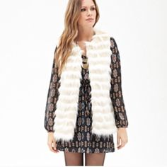Striped Faux Fur Vest - Cream & Beige NWOT - SIZE: XS (picture show's a size large, taken from another posting of the same vest with original tags still attached) | Shell: 77%Modacrylic 15%Polyester 8%Acrylic Lining: 100%Polyester Forever 21 Other