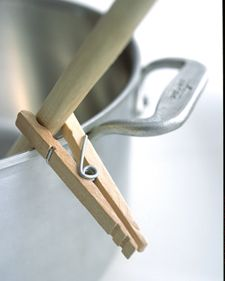 Spoon Catcher   Clip a wooden clothespin to the spoon handle so it catches on the rim of the pot.