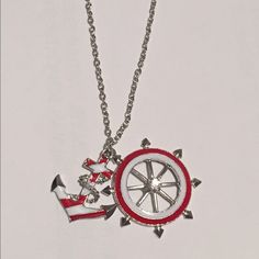 New anchor and wheel necklace Red and white anchor and wheel necklace with long silver chain ❗️new two available ❗️ Jewelry Necklaces