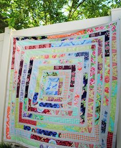 Hideaway Girl: Scrappy LOVE Jelly Roll Quilt...don'tcha think this would be FABULOUS in neutrals with red inner lines?! I do!